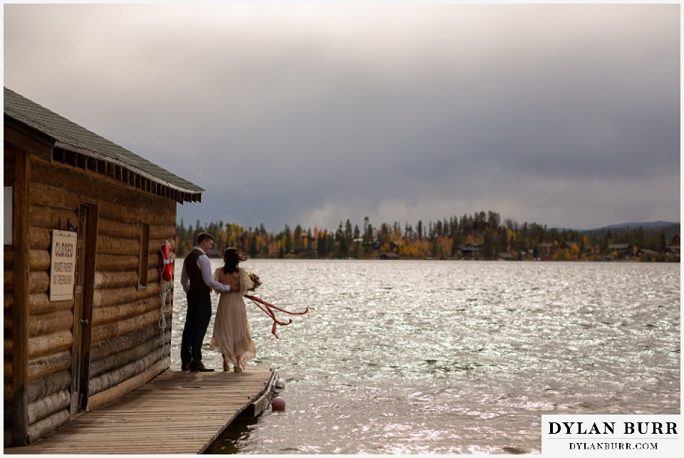 grand lake wedding elopement bride and groom on boat house