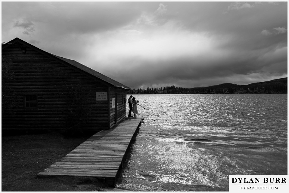 grand lake wedding elopement bride and groom at boat house black and white