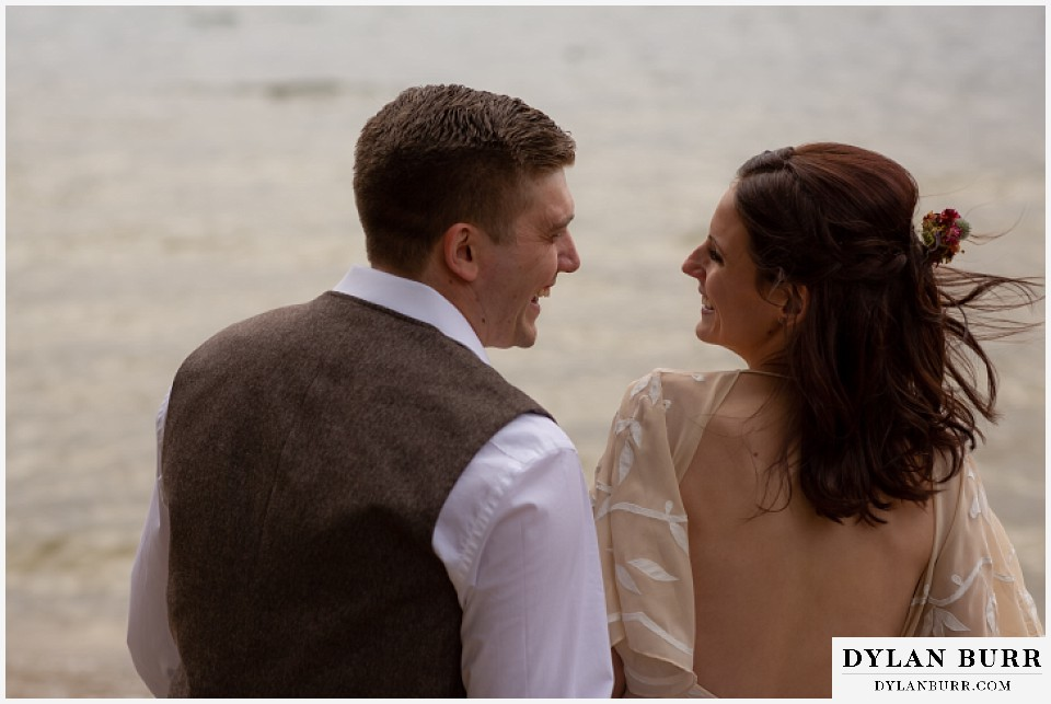 grand lake wedding elopement bride and groom laughing together