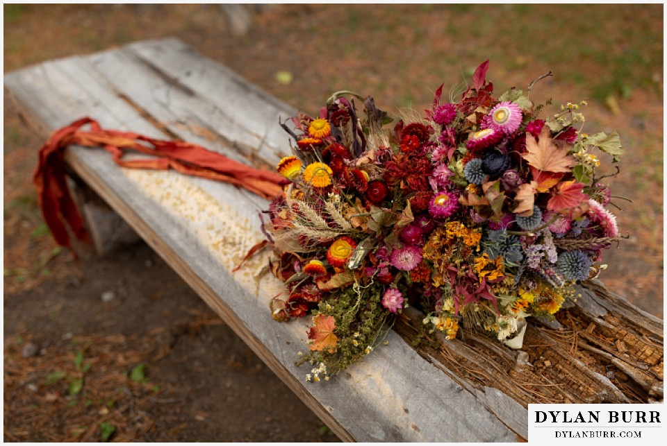 grand lake wedding elopement fall wedding bouquet with dried flowers native corn grasses and wheat