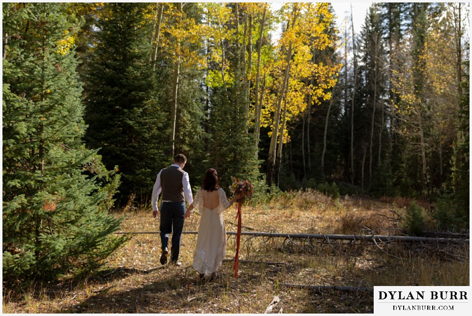 grand lake wedding elopement bride and groom walking into fall colors