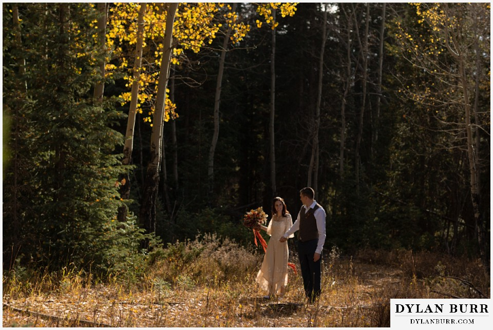 rocky mountain national park grand lake wedding elopement bride and groom walking in aspen trees