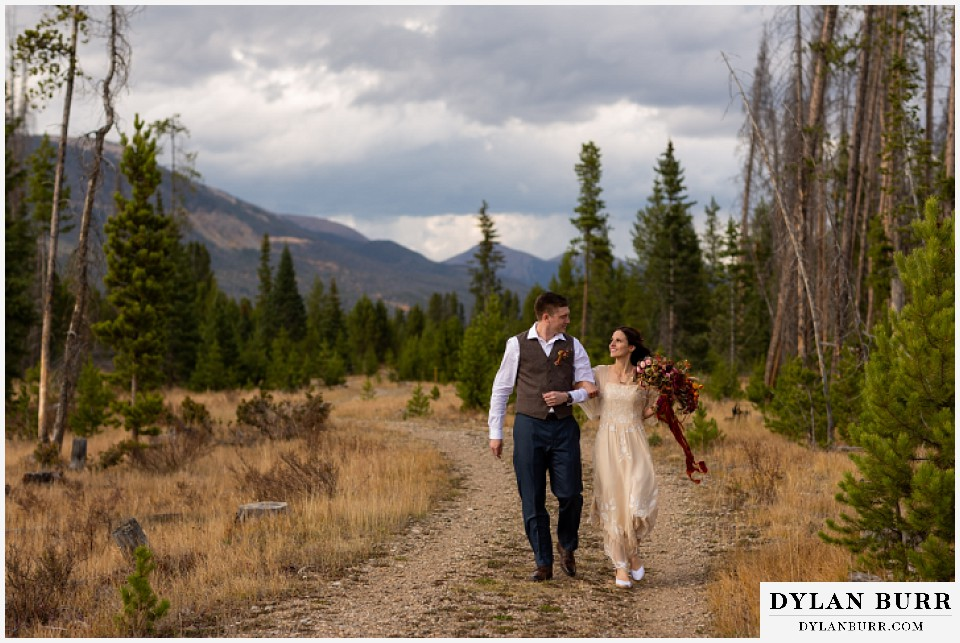 rocky mountain national park grand lake wedding elopement bride and groom walking in mountain valley