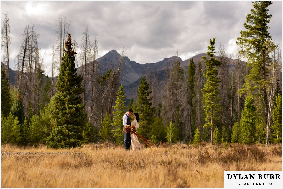 rocky mountain national park grand lake wedding elopement bride and groom sharing a moment in the mountains