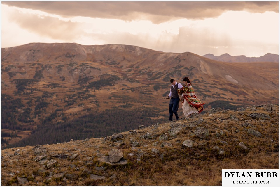 rocky mountain national park grand lake wedding elopement bride and groom walking down mountain side
