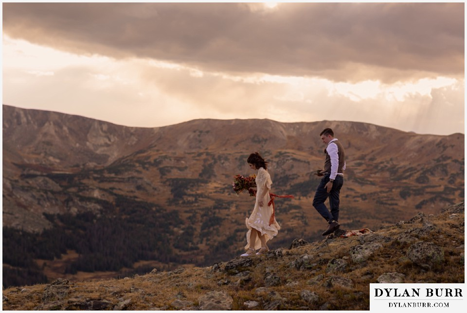 rocky mountain national park grand lake wedding elopement bride and groom walking down to ceremony site