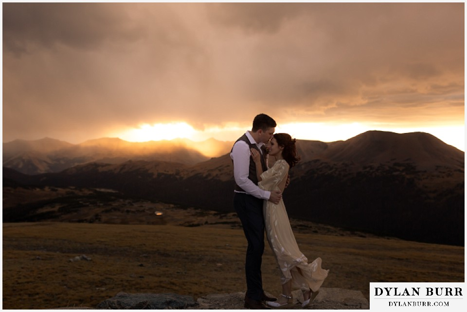 rocky mountain national park grand lake wedding elopement groom kissing brides forehead on sunset