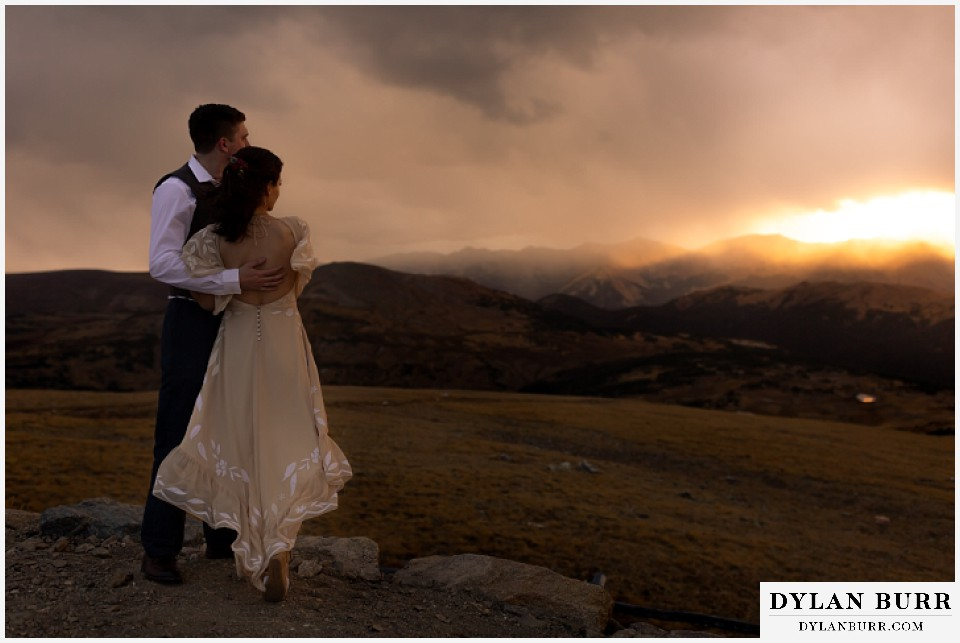 rocky mountain national park grand lake wedding elopement bride and groom holding each other on a mountain enjoying the sunset