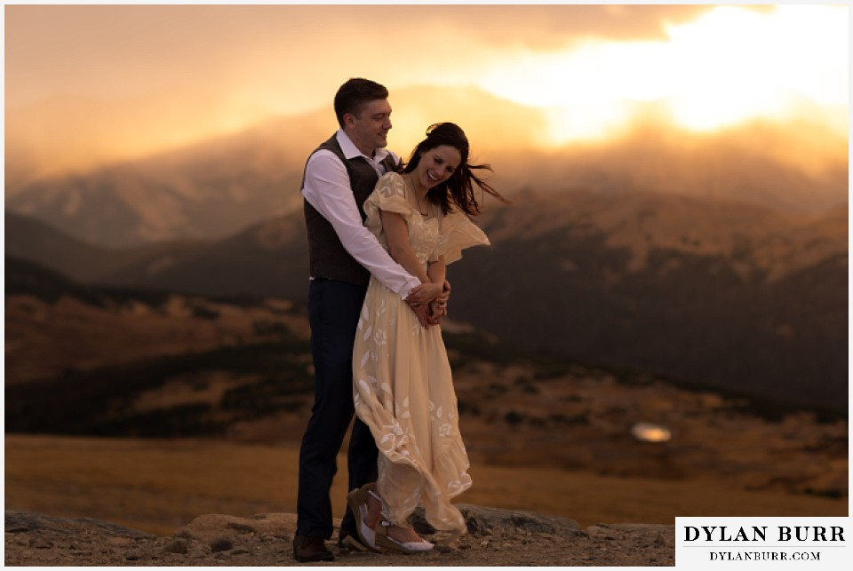 rocky mountain national park grand lake wedding elopement bride and groom laughing at sunset