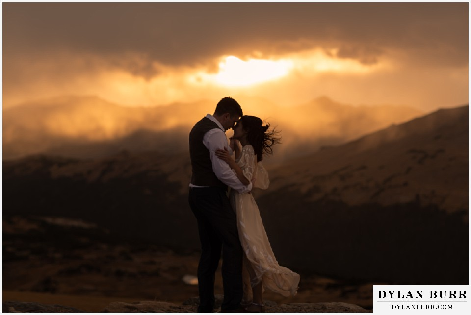 rocky mountain national park grand lake wedding elopement bride and groom snuggling up at sunset