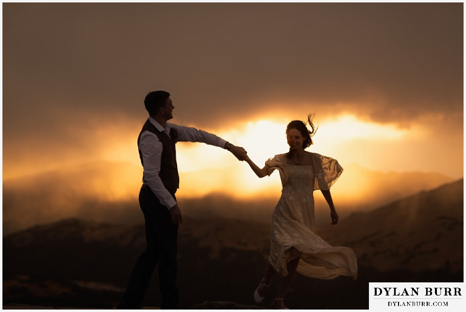 rocky mountain national park grand lake wedding elopement bride and groom dancing together in the sunset