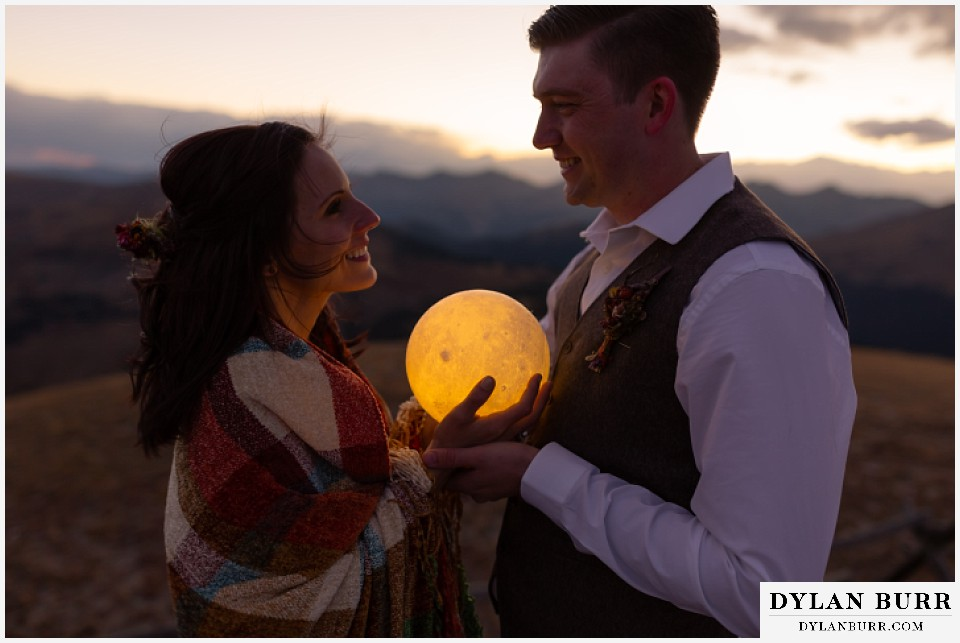 rocky mountain national park grand lake wedding elopement bride and groom holding moon during harvest moon