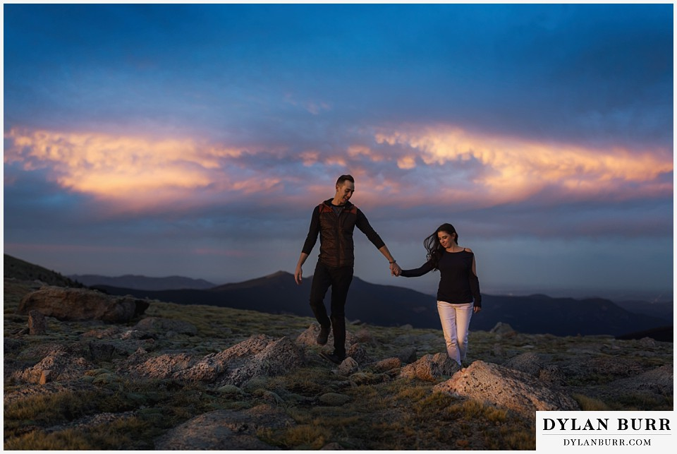 how to prepare for my engagement session couple walking together on top of mountains