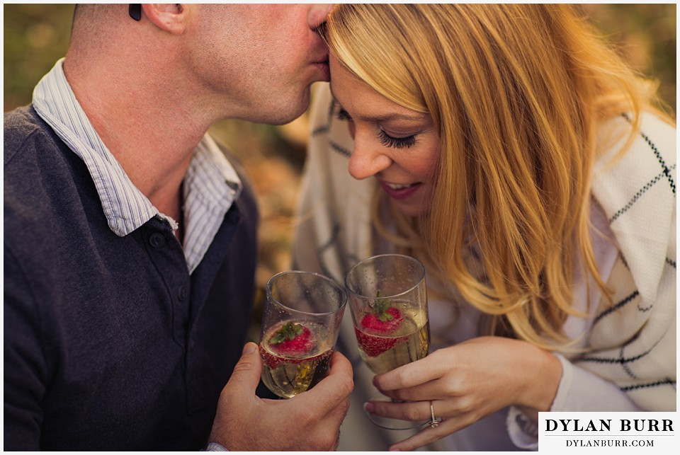 how to prepare for my engagement session couple drinking strawberries in champagne