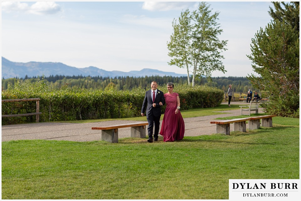 jackson lake lodge wedding grand tetons wyoming mother of bride walking to ceremony site