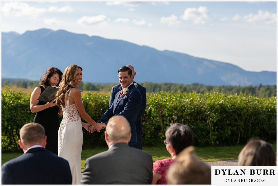 jackson lake lodge wedding grand tetons wyoming bride and groom acknowledging their guests