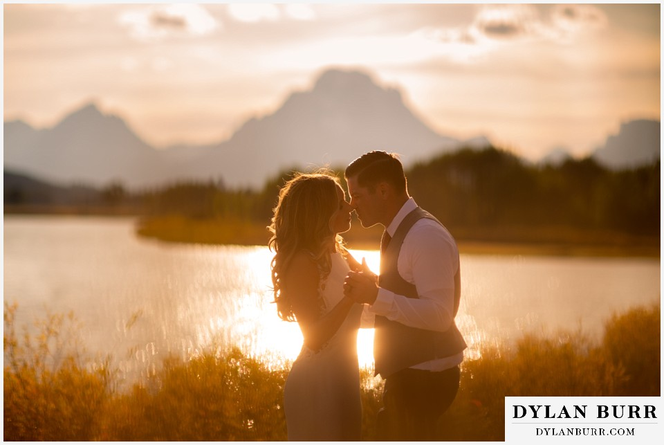 jackson lake lodge wedding grand tetons wyoming bride and groom going in close for a kiss at sunset
