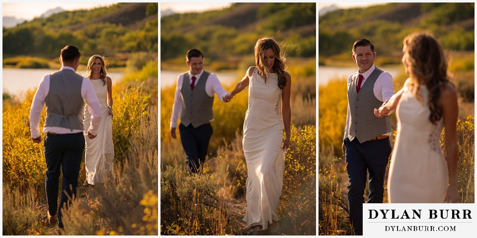 jackson lake lodge wedding grand tetons wyoming bride and groom walking together near river
