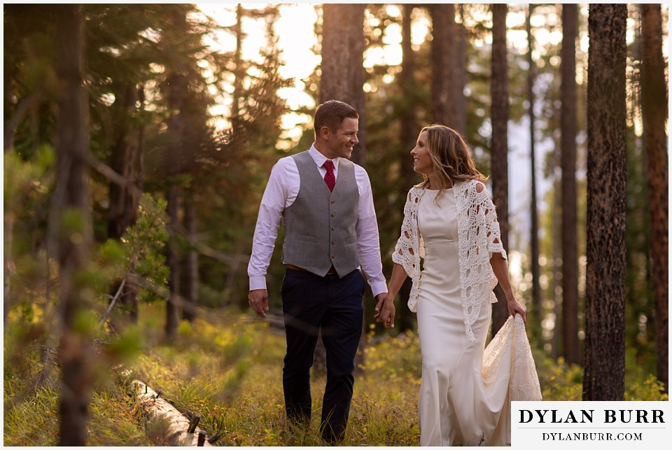 jackson lake lodge wedding grand tetons wyoming bride and groom in forest at sunset
