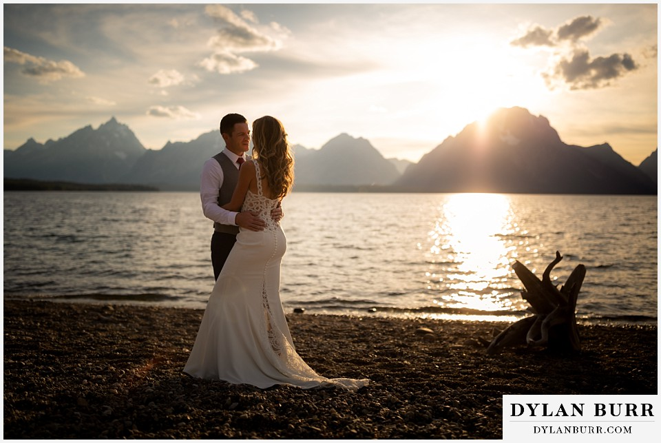 jackson lake lodge wedding grand tetons wyoming groom and his bride in the mountains by the lake