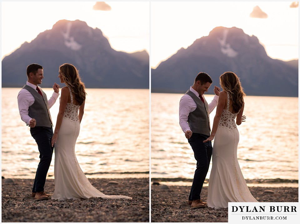 jackson lake lodge wedding grand tetons wyoming bride and groom dancing lakeside with mt moran in background at sunset
