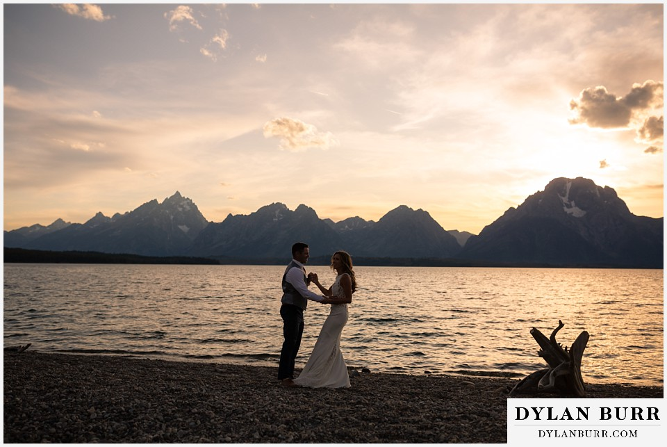 jackson lake lodge wedding grand tetons wyoming bride and groom dancing with grand teton in background