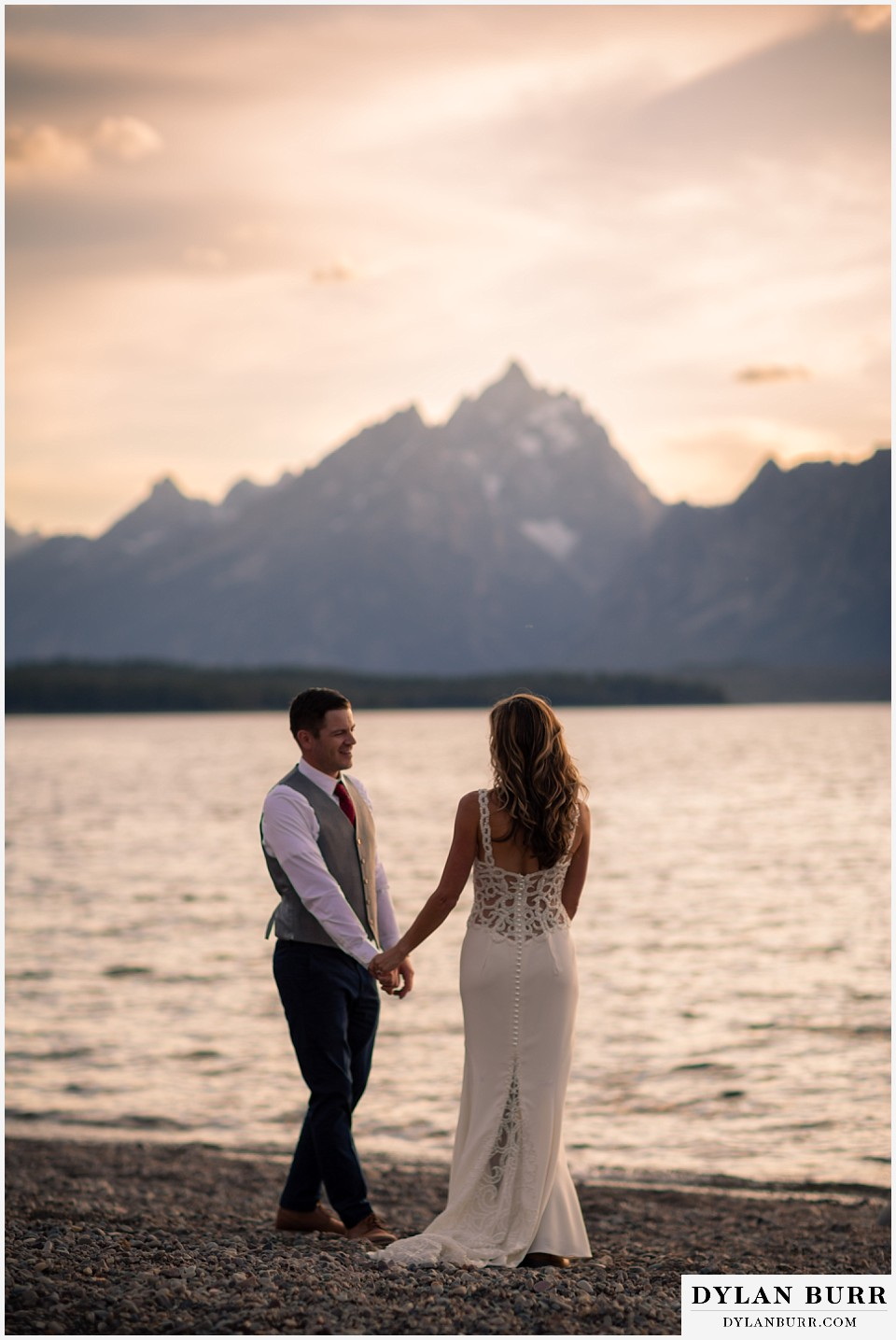 jackson lake lodge wedding grand tetons wyoming bride and groom swaying together with grand teton in background