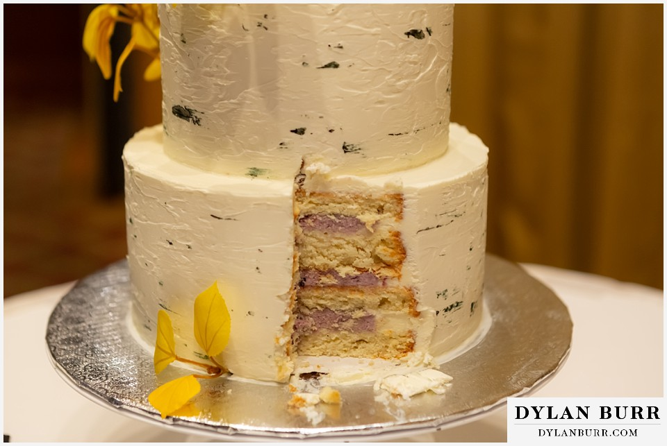 jackson lake lodge wedding grand tetons wyoming close up of wedding cake with huckleberry frosting
