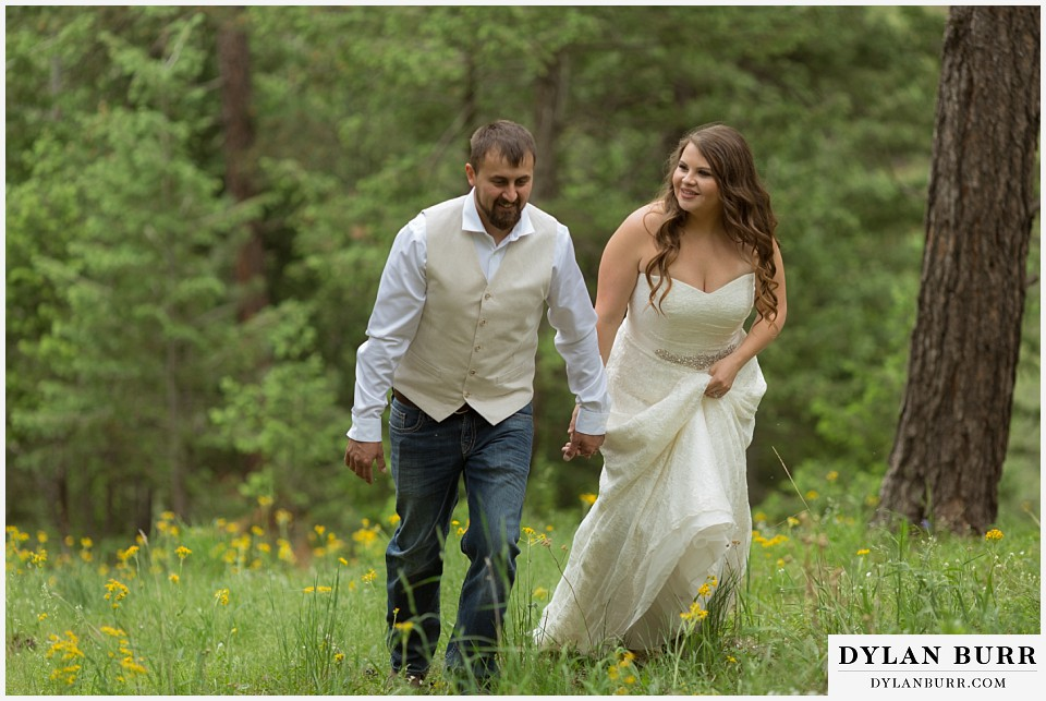 colorado mountain elopement lost gulch overlook wedding boulder co walking in grass