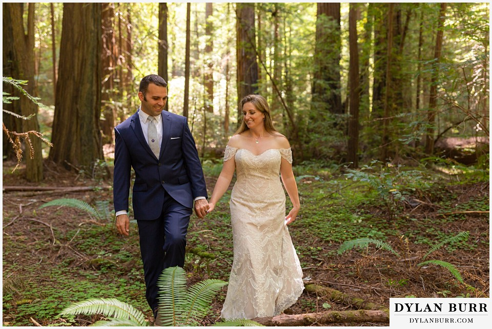 redwood forest wedding elopement avenue of the giants california bride and groom walking together in forest