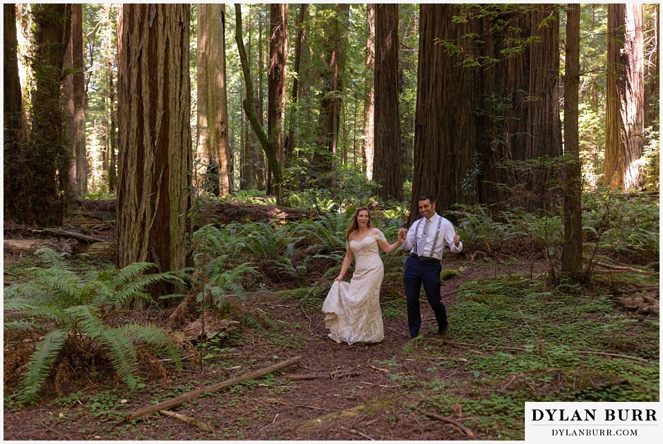 redwood forest wedding elopement avenue of the giants california bride and groom dancing in forest