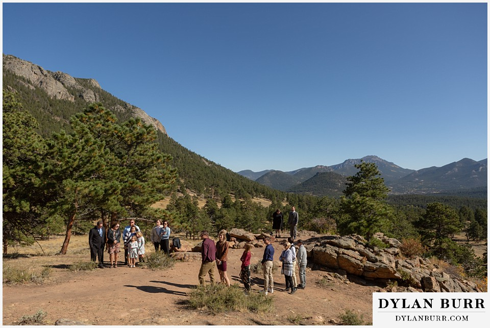 rocky mountain national park elopement wedding family and groom awaiting the bride
