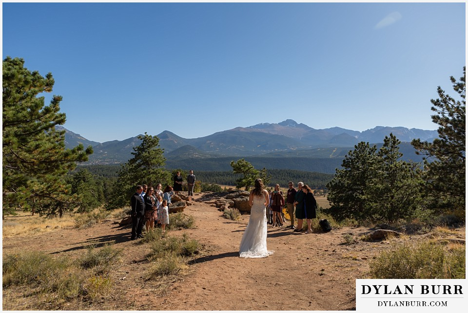 rocky mountain national park elopement wedding bride enters ceremony with family around her