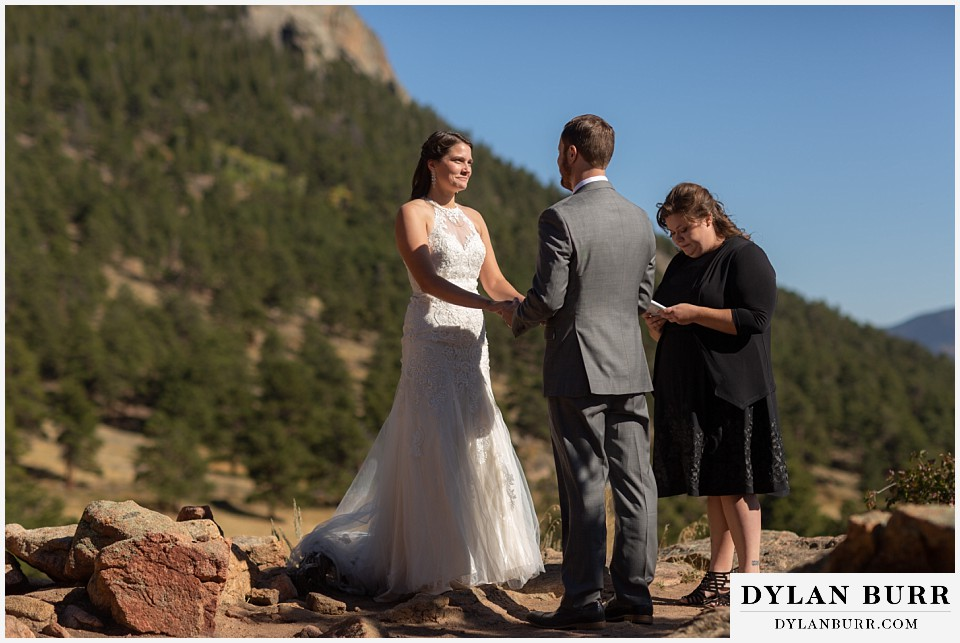 rocky mountain national park elopement wedding bride looking at groom with so much love