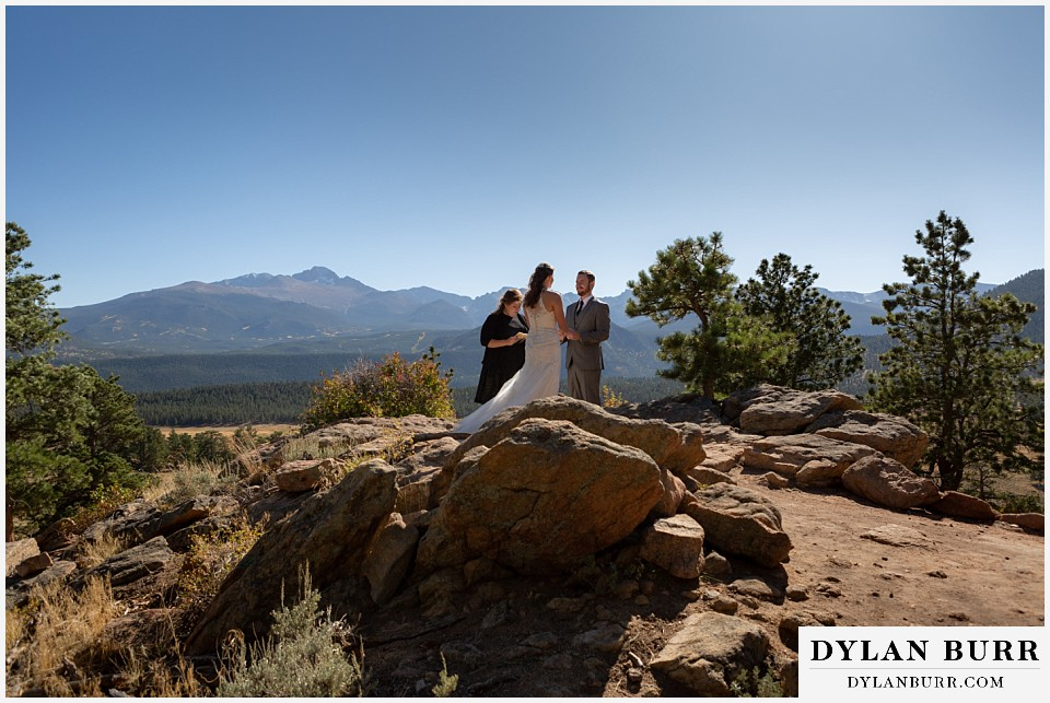 rocky mountain national park elopement wedding groom looking on at bride
