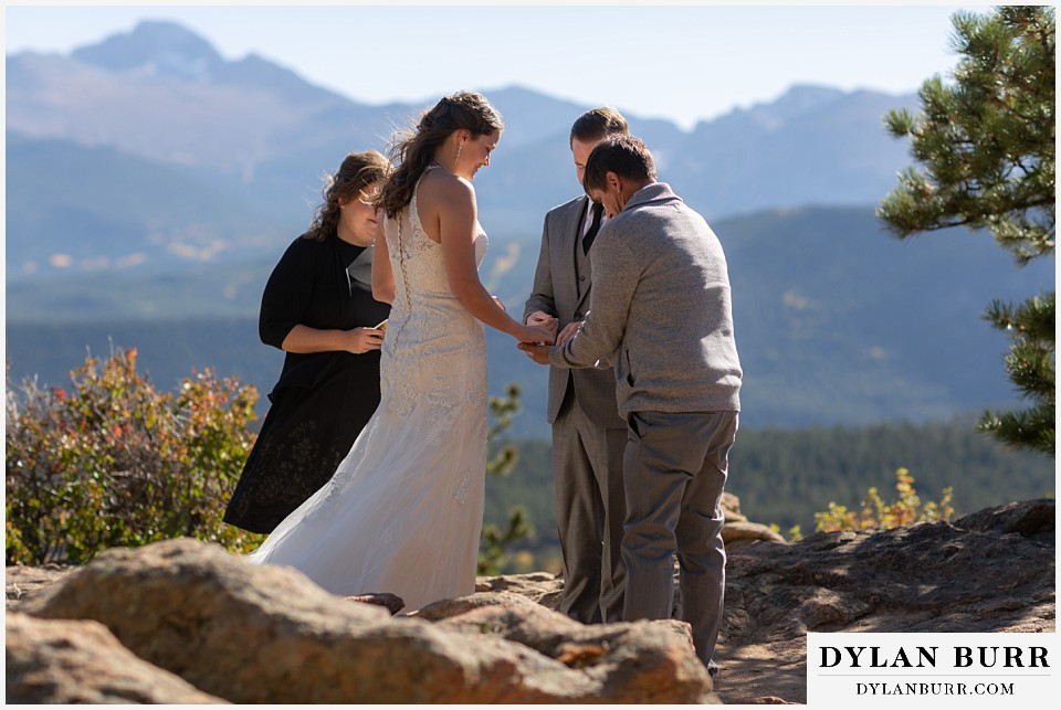 rocky mountain national park elopement wedding father brings in rings