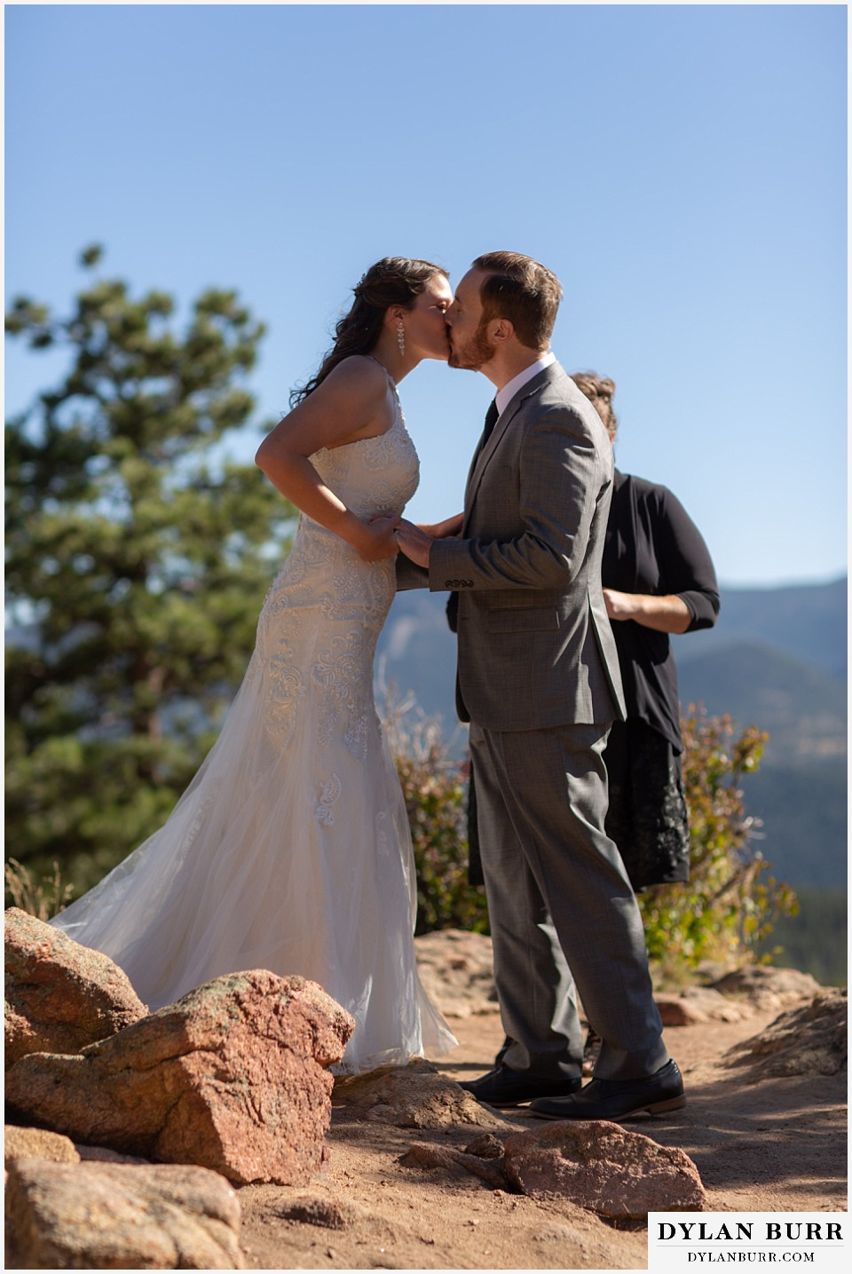 rocky mountain national park elopement wedding bride and groom first kiss
