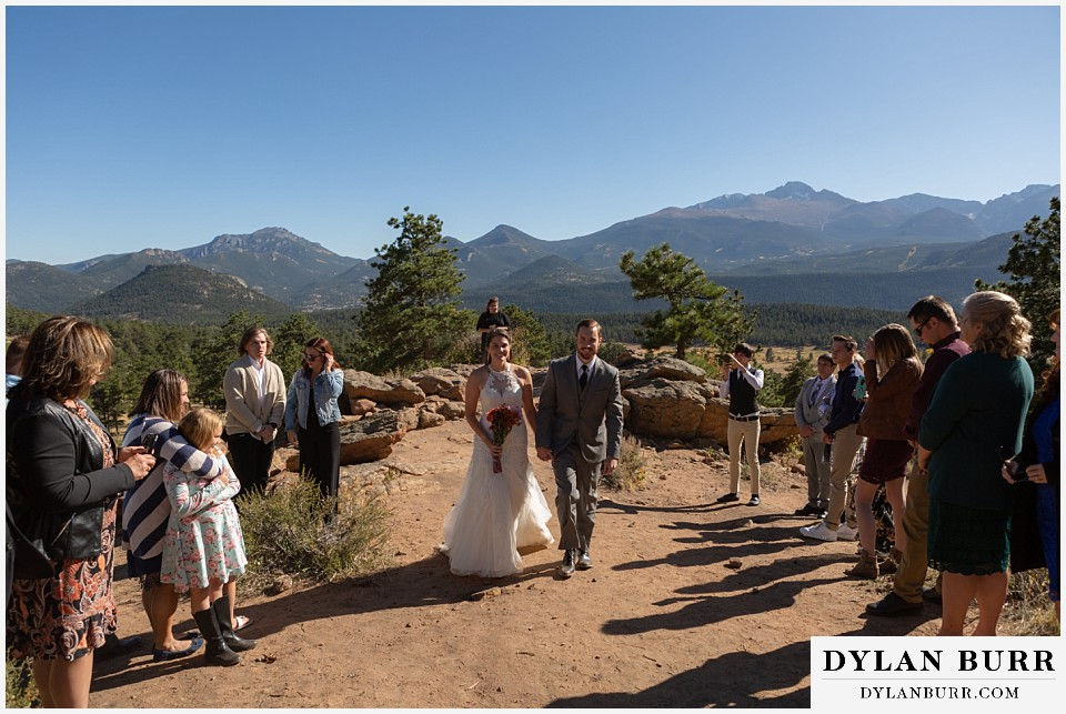 rocky mountain national park elopement wedding wife husband walking out of ceremony