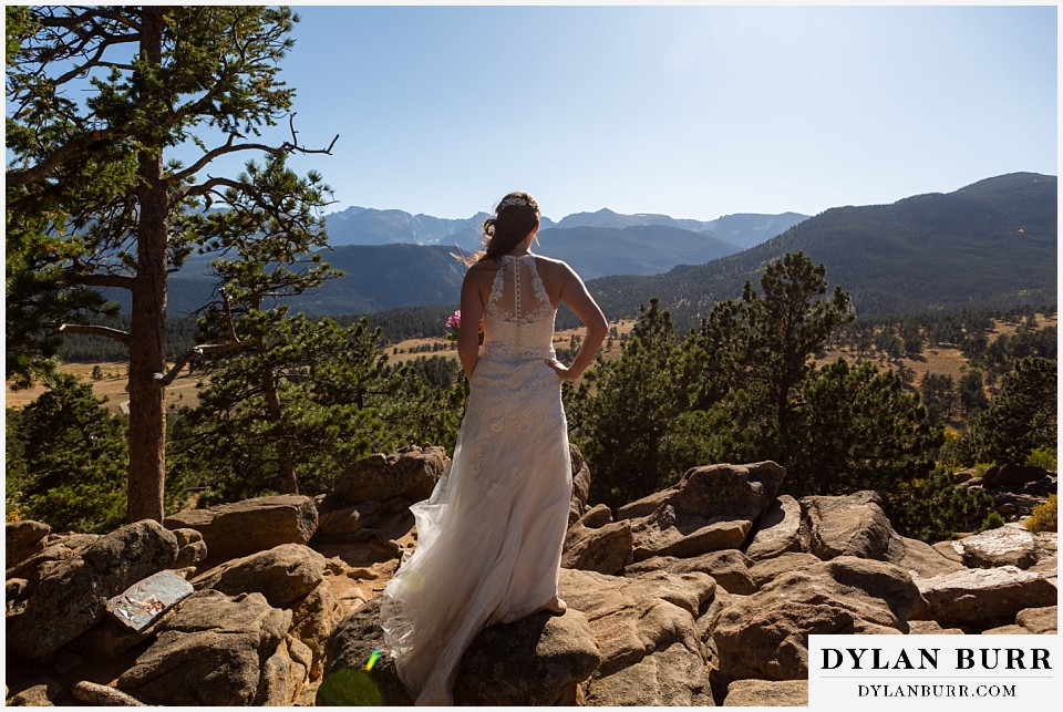 rocky mountain national park elopement wedding bride looks out over valley