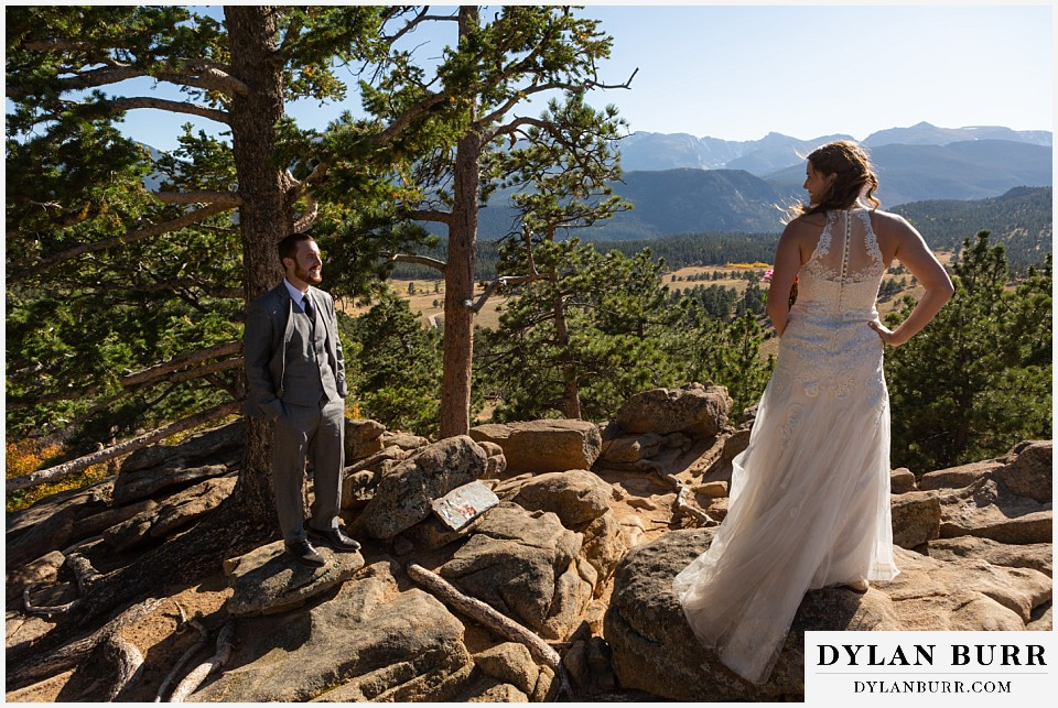 rocky mountain national park elopement wedding groom looks on at his wife