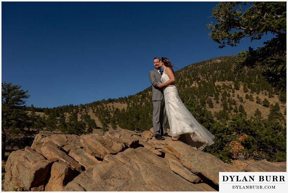 rocky mountain national park elopement wedding bride and groom on a mountain top