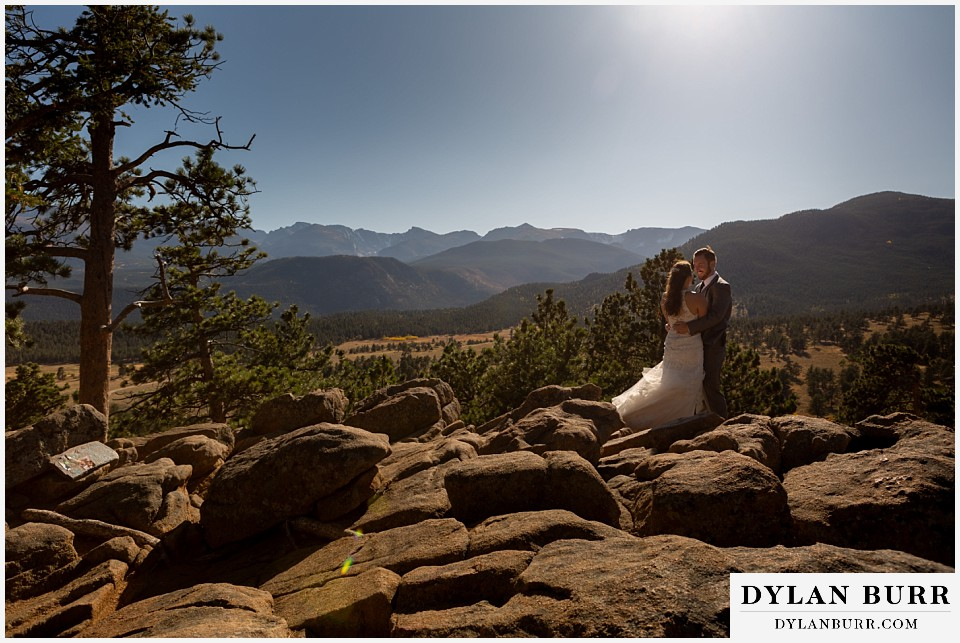 rocky mountain national park elopement wedding bride and groom on rocky ledge