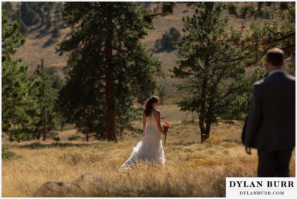 rocky mountain national park elopement wedding groom walking down hill to his bride