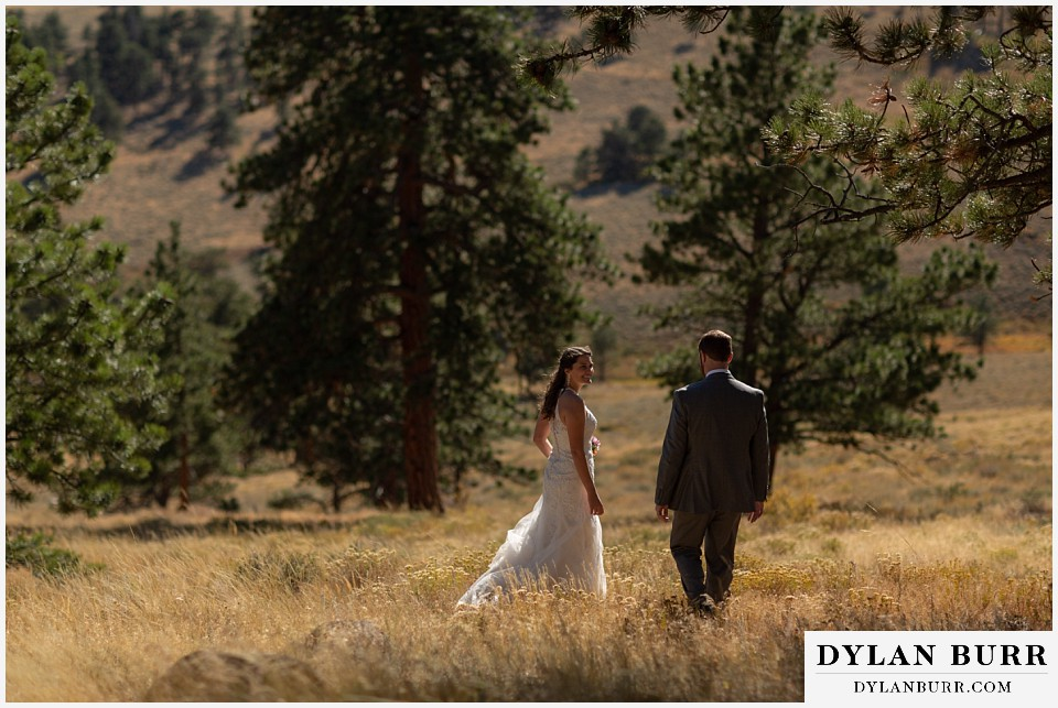 rocky mountain national park elopement wedding groom meets up with bride