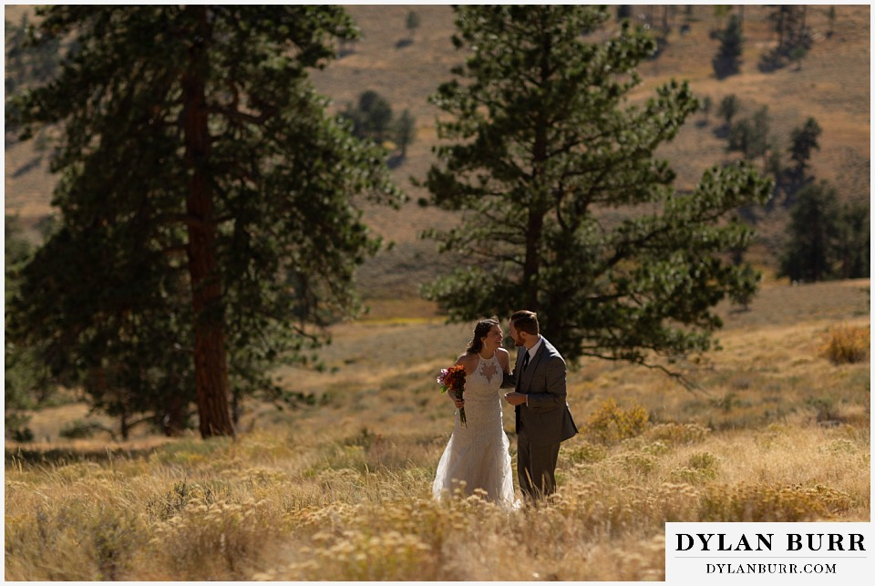 rocky mountain national park elopement wedding bride and groom laughing together
