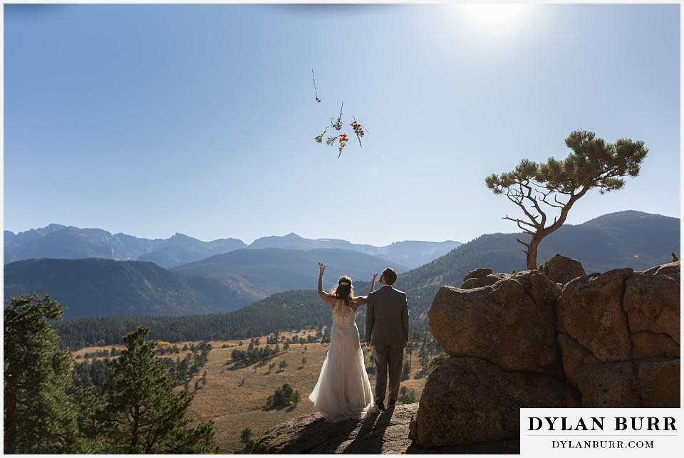 rocky mountain national park elopement wedding bride tossing bouquet into air