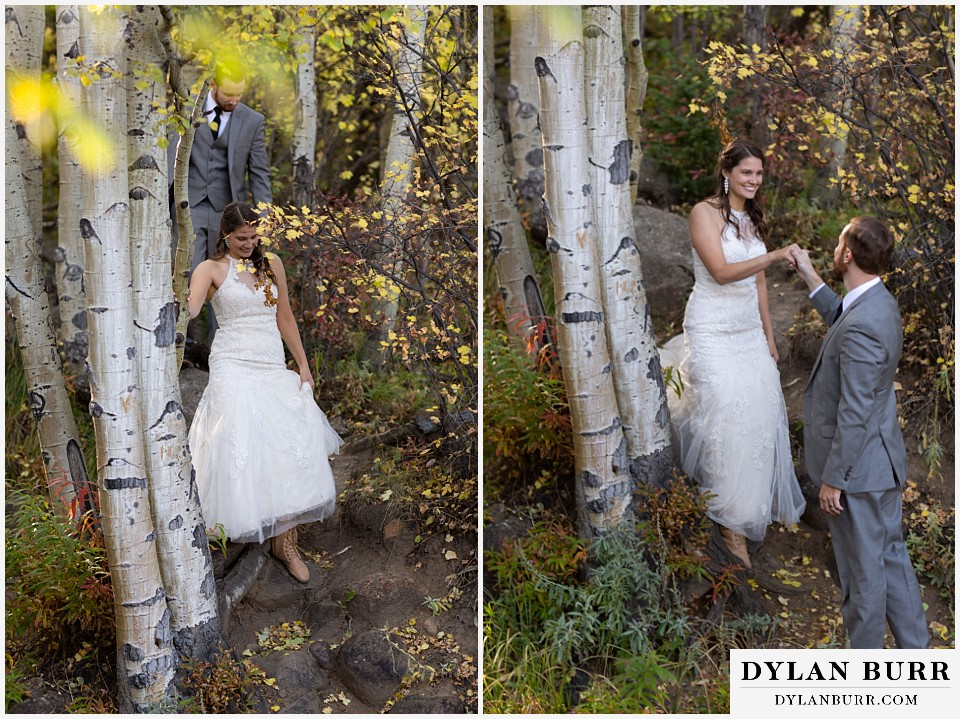 rocky mountain national park elopement wedding groom helping bride down in forest