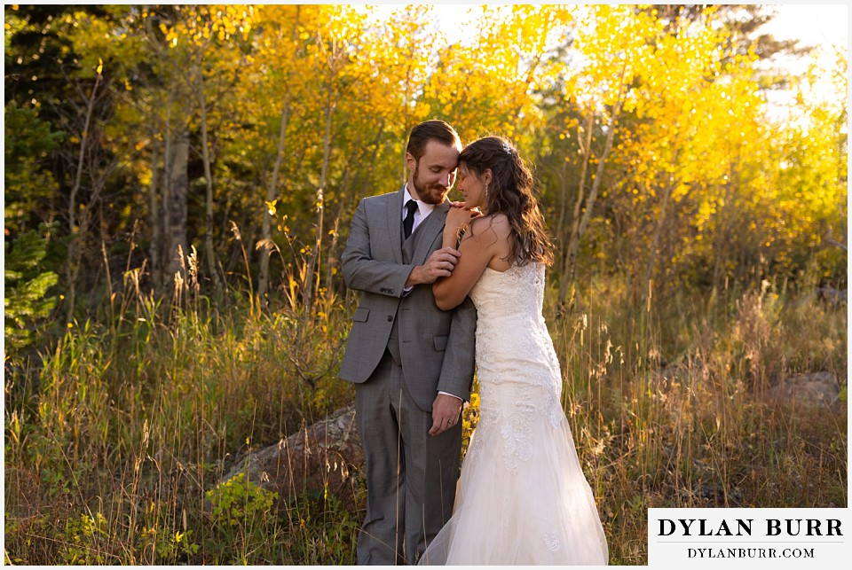 rocky mountain national park elopement wedding husband and wife close together in forest
