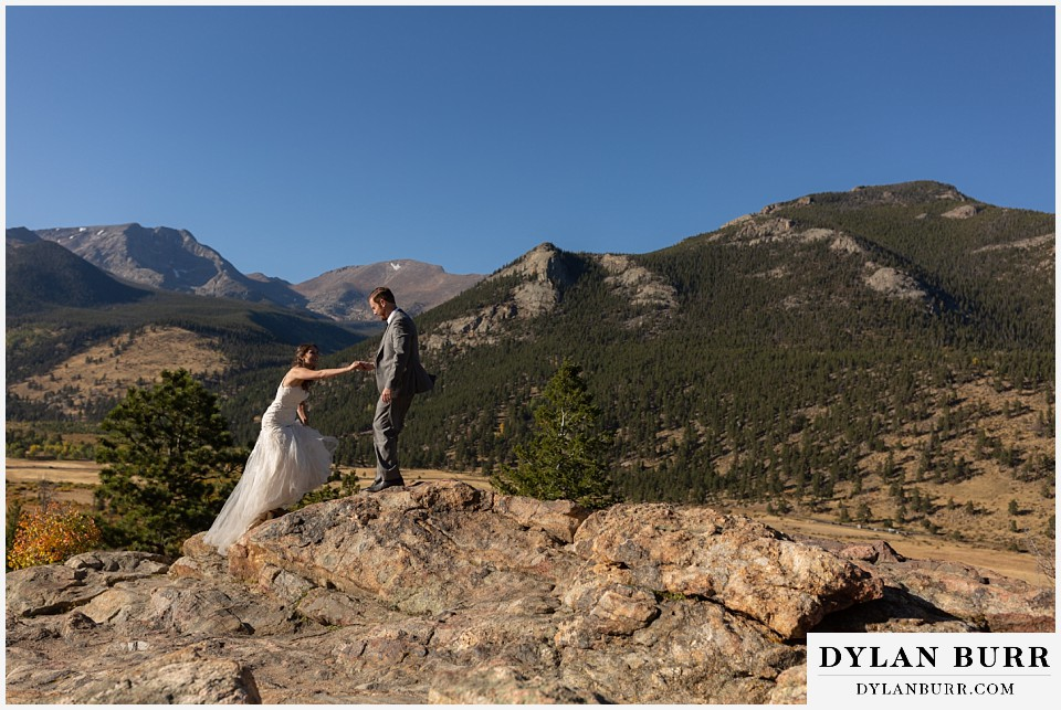 rocky mountain national park elopement wedding bride and groom walking up mountain