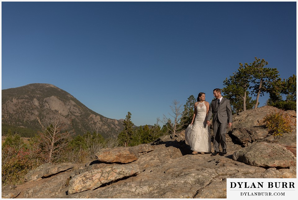 rocky mountain national park elopement wedding bride and groom on rocks